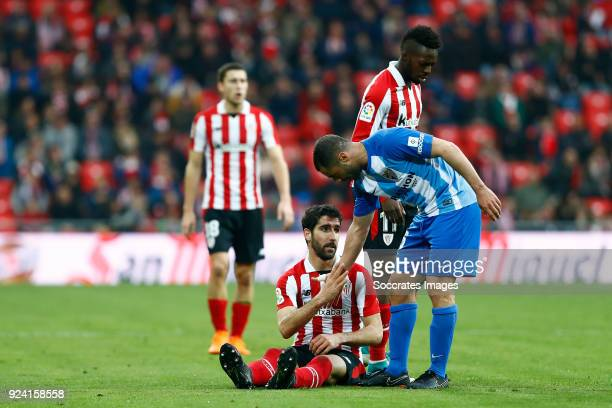 Raul Garcia of Athletic Bilbao Medhi Lacen of Malaga CF during the La Liga Santander match between Athletic de Bilbao v Malaga at the Estadio San...
