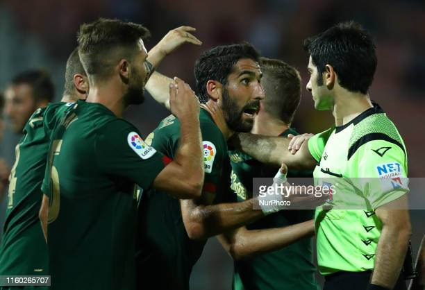 Raul Garcia of Athletic Bilbao reclaims with the referee Fabio Maresca for the penalty awarded to Roma during the friendly match AS Roma v Athletic...