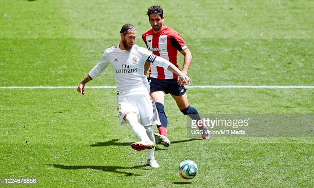 Raul Garcia of Athletic Club and Sergio Ramos of Real Madrid CF in action during the Liga match between Athletic Club and Real Madrid CF at San Mames...