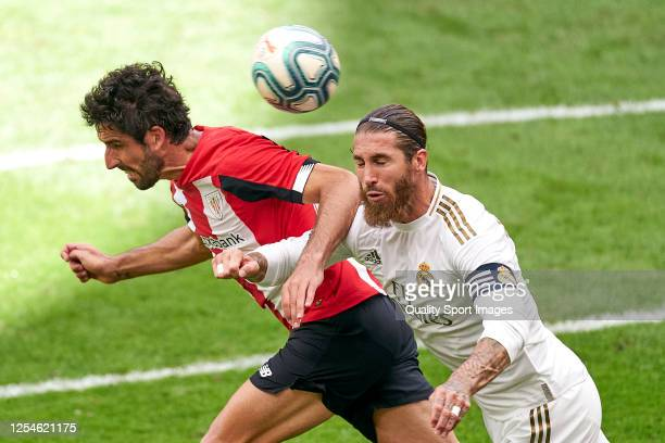Raul Garcia of Athletic Club battle for the ball with Sergio Ramos of Real Madrid CF during the Liga match between Athletic Club and Real Madrid CF...