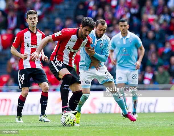 Raul Garcia of Athletic Club Bilbao competes for the ball with Marcelo Diaz of RC Celta de Vigo during the La Liga match between Athletic Club Bilbao...