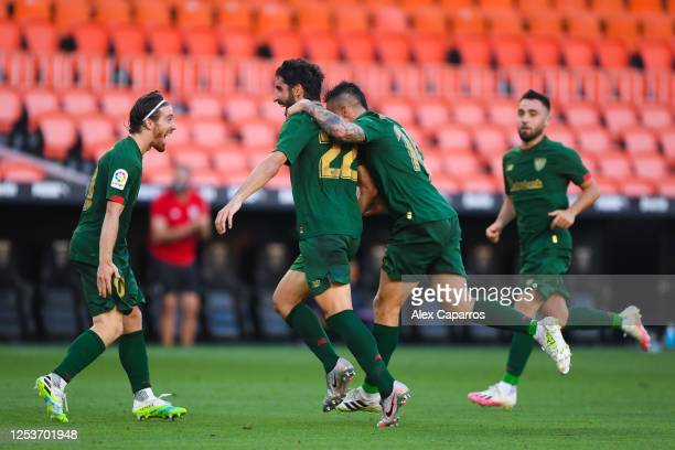 Raul Garcia of Athletic Club celebrates with his team mates after scoring his team's second goalduring the Liga match between Valencia CF and...