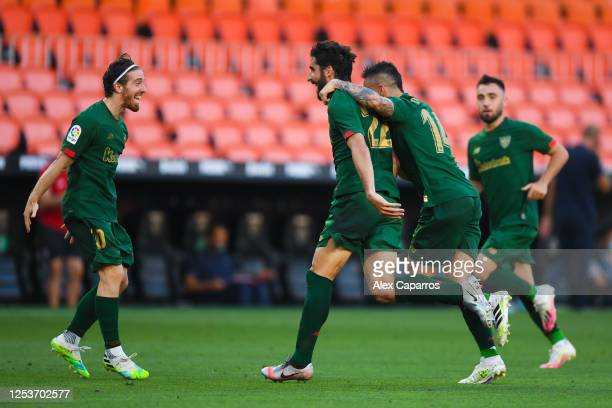 Raul Garcia of Athletic Club celebrates with his team mates Iker Muniain and Dani Garcia after scoring his team's second goalduring the Liga match...