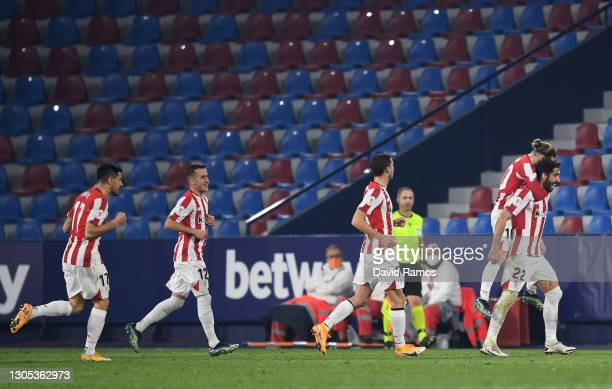 Raul Garcia of Athletic Club celebrates with teammate Iker Muniain after scoring his team's first goal during the Copa del Rey Semi Final Second Leg...