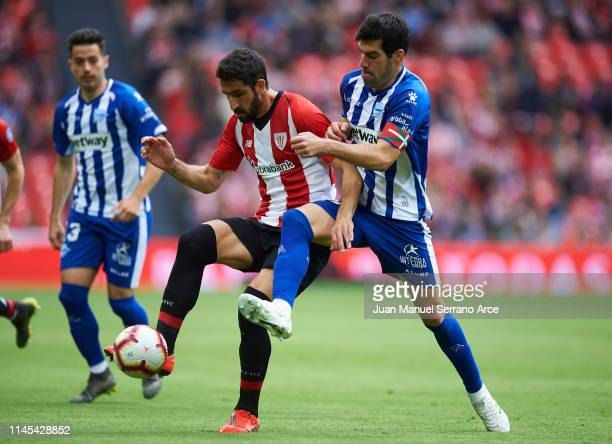 Raul Garcia of Athletic Club duels for the ball with Manuel Garcia of Deportivo Alaves during the La Liga match between Athletic Club and Deportivo...