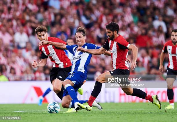 Raul Garcia of Athletic Club duels for the ball with Tomas Pina of Deportivo Alaves during the Liga match between Athletic Club and Deportivo Alaves...