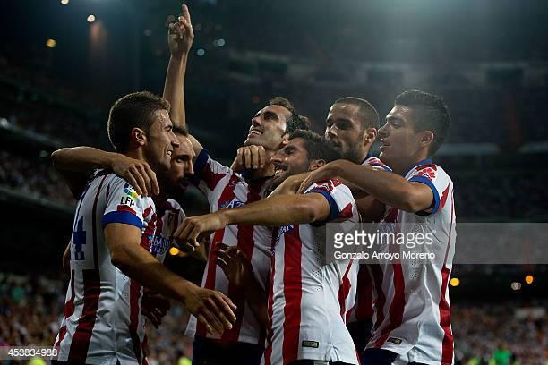 Raul Garcia of Atletico de Madrid celebrates scoring the opening goal with teammates Raul Jimenez , Mario Suarez , Diego Godin , Juan Francisco...