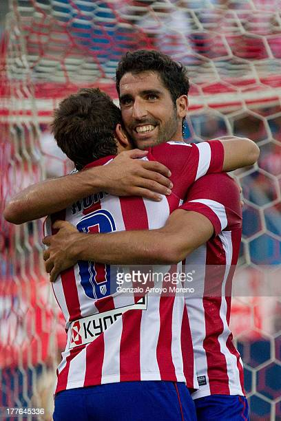 Raul Garcia of Atletico de Madrid celebrates scoring their fifth goal with teammate Koke during the La Liga match between Club Atletico de Madrid and...