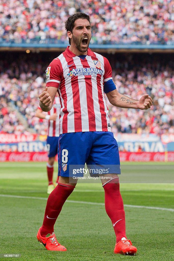 Raul Garcia of Atletico de Madrid celebrates scoring their opening goal during the La Liga match between Club Atletico de Madrid and Villarreal CF at Vicente Calderon Stadium on April 5, 2014 in Madrid, Spain.
