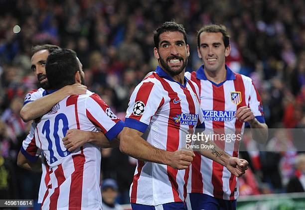 Raul Garcia of Club Atletico de Madrid celebrates after scoring his team's opening goal during the UEFA Champions League Group A match between Club...