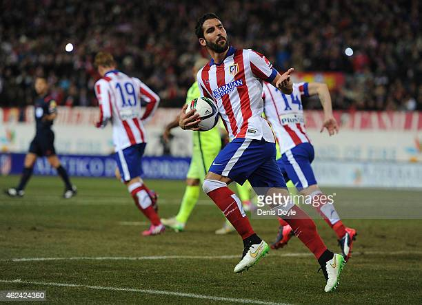 Raul Garcia of Club Atletico de Madrid celebrates after scoring his team's 2nd goal during the Copa del Rey Quarter Final Second Leg match between...