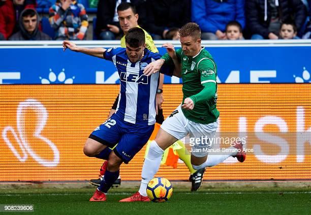 Raul Garcia of Club Deportivo Leganes duels for the ball with Martin Aguirregabiria of Deportivo Alaves during the La Liga match between Deportivo...