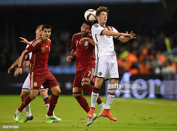 Raul Garcia of Spain competes for a header with Erik Durm of Germany during the International Friendly match between Spain and Germany at Estadio...