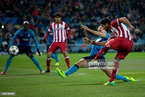 Raul Garcia scores their opening goal during the UEFA Champions League Group G match at Vicente Calderon Stadium on December 11 2013 in Madrid Spain