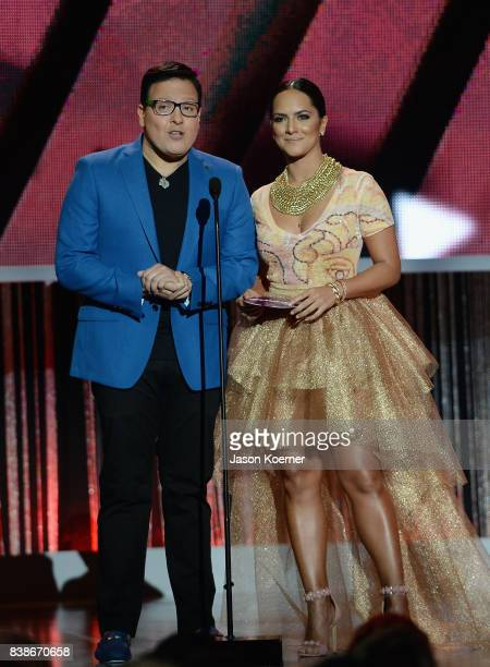Raul Gonzalez and Ana Lorena Sanchez on stage at Telemundo's 2017 'Premios Tu Mundo' at American Airlines Arena on August 24 2017 in Miami Florida
