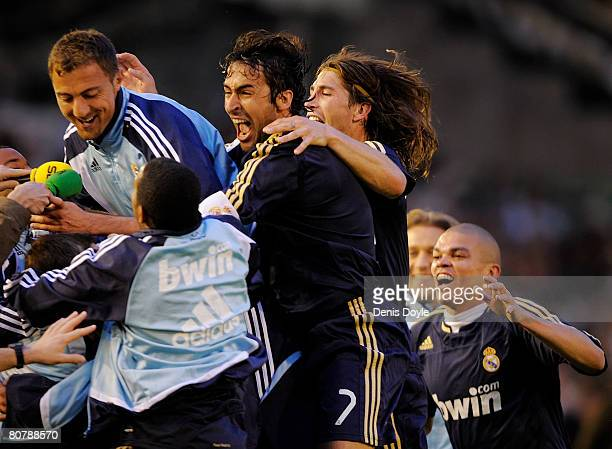 Raul Gonzalez and Real Madrid teammates mob Gonzalo Higuain after he scored Real's second goal during the Liga match between Racing Santander and...