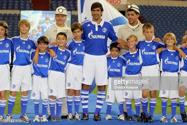 Raul Gonzalez and the young player pose during the FC Schalke press conference at the Veltins Arena on July 28 2010 in Gelsenkirchen Germany FC...