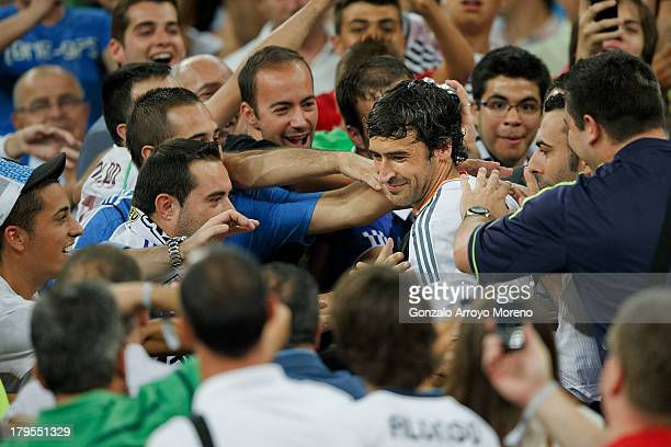 Raul Gonzalez Blanco ex player of Real Madrid is greeted by the audience after leaving the honor suit of Santiago Bernabeu stadium prior to start the...