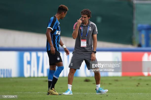 Raul Gonzalez Blanco Head coach of Real Madrid demonstrates compassion towards Thomas Schiro following Internazionale's elimination from the...