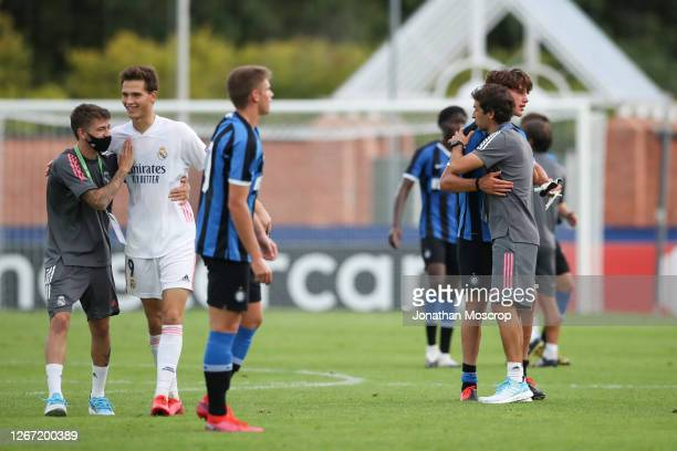 Raul Gonzalez Blanco Head coach of Real Madrid embraces Cesare Casadei following Internazionale's elimination from the competition during the UEFA...