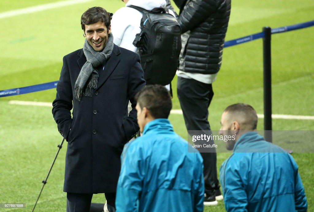 Raul Gonzalez Blanco looks on while Raphael Varane and Karim Benzema of Real Madrid enter the pitch during Real Madrid's training on the eve of UEFA Champions League match between Paris Saint Germain (PSG) and Real Madrid at Parc des Princes stadium on March 5, 2018 in Paris, .