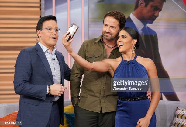Raul Gonzalez Gerard Butler and Francisca Lachapel are seen on the set of Despierta America at Univision Studios to promote the film Angel Has Fallen...