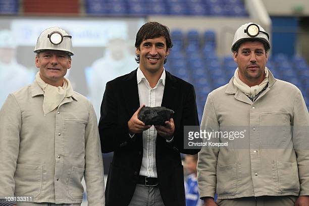 Raul Gonzalez gets a piece of coal as a present during the FC Schalke press conference at the Veltins Arena on July 28 2010 in Gelsenkirchen Germany...
