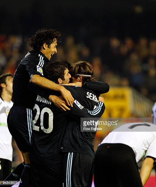 Raul Gonzalez Gonzalo Higuain and Sergio Ramos celebrates the third goal of their team during the La Liga match between Valencia and Real Madrid at...