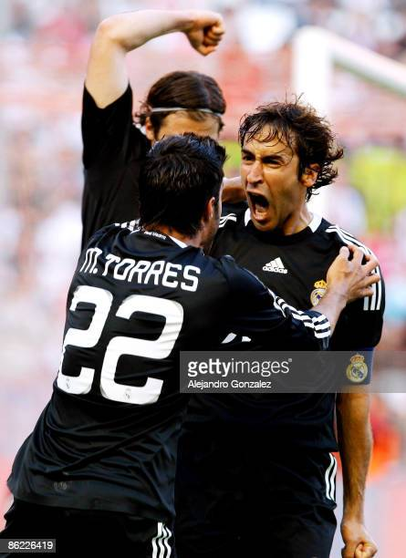 Raul Gonzalez of Real Madrid celebrates his goal with Miguel Torres during the La Liga match between Sevilla and Real Madrid at Sanchez Pizjuan...
