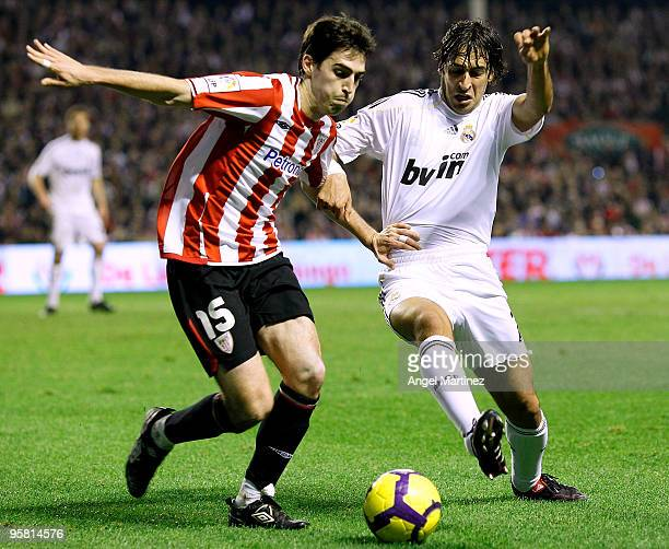 Raul Gonzalez of Real Madrid competes for the ball with Andoni Iraola of Athletic Bilbao during the La Liga match between Athletic Bilbao and Real...
