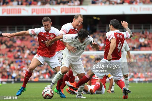 Raul Gonzalez of Real Madrid in action with Matthew Upson, Ray Parlour and David Hillier of Arsenal during the match between Arsenal Legends and Real...
