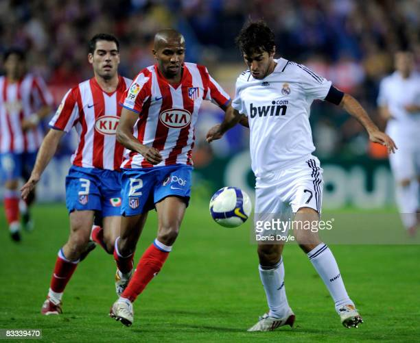 Raul Gonzalez of Real Madrid is challenged by Paulo Assuncao of Atletico Madrid during the La Liga match between Atletico Madrid and Real Madrid at...