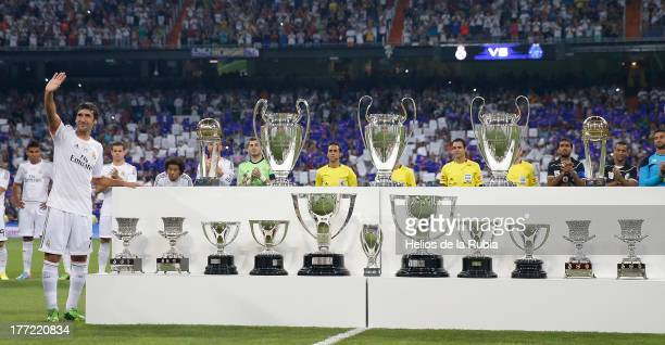 Raul Gonzalez of Real Madrid poses with the trophies wonduring the Santiago Bernabeu Trophy match between Real Madrid CF and AlSadd at Bernabeu on...