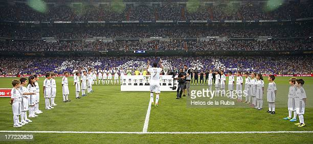 Raul Gonzalez of Real Madrid walks among childrens during the Santiago Bernabeu Trophy match between Real Madrid CF and AlSadd at Bernabeu on August...