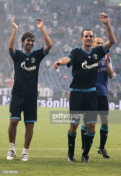Raul Gonzalez of Schalke and Christoph Metzelder dance after winning 3-1 the LIGA total! Cup 2010 final match between FC Bayern Muenchen and FC...