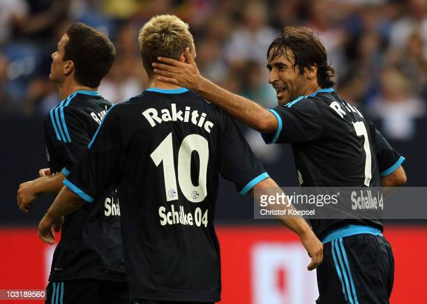 Raul Gonzalez of Schalke celebrates the second goal with Ivan Rakitic during the LIGA total Cup 2010 final match between FC Bayern Muenchen and FC...