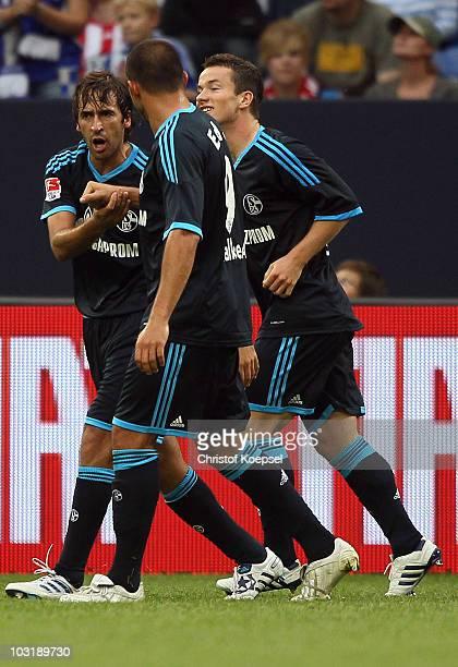 Raul Gonzalez of Schalke celebrates the third goal witrh Edu and Alexander Baumjoha during the LIGA total Cup 2010 final match between FC Bayern...