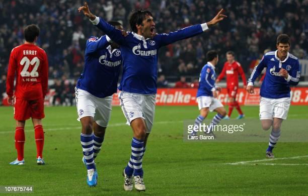 Raul Gonzalez of Schalke celebrates with team mate Jefferson Farfan after scoring his teams first goal during the Bundesliga match between FC Schalke...