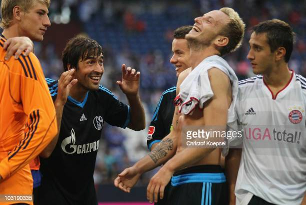 Raul Gonzalez of Schalke makes nonsense with Ivan Rakitic during the LIGA total Cup 2010 final match between FC Bayern Muenchen and FC Schalke 04 at...