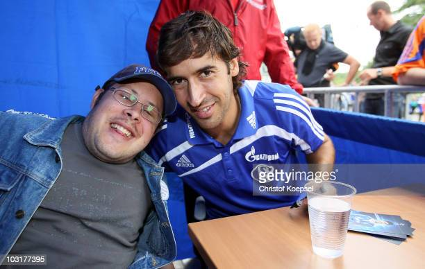 Raul Gonzalez of Schalke poses with a fan during the FC Schalke 04 season opening around the Veltins Arena on July 31 2010 in Gelsenkirchen Germany