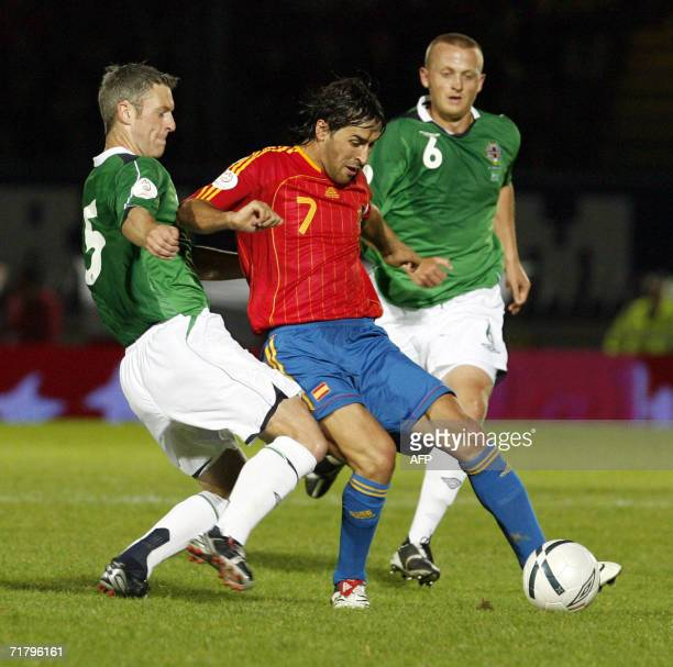 Raul Gonzalez of Spain fights for the ball with Stephen Craigan and Sammy Clingan of Northern Ireland 06 September 2006 during the 2008 European...