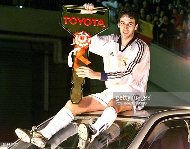 Raul Gonzalez of Spain's Real Madrid shows off the key to Toyota's sports car 'Altezza' as he won the MVP award during the Toyota Cup...
