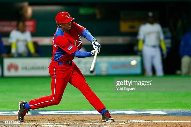 Raul Gonzalez of Team Cuba hits a RBI ground out during Pool A Game 2 between Team Cuba and Team Brazil during the first round of the 2013 World...