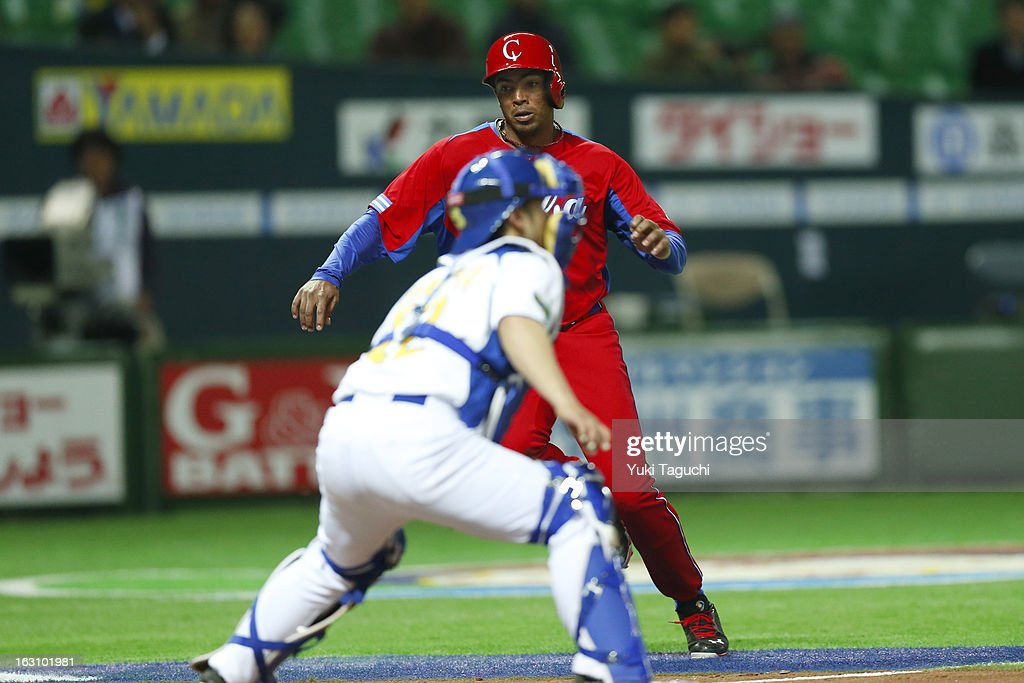 Raul Gonzalez #7 of Team Cuba scores in the top of the sixth inning during Pool A, Game 2 between Team Cuba and Team Brazil during the first round of the 2013 World Baseball Classic at the Fukuoka Yahoo! Japan Dome on Sunday, March 3, 2013 in Fukuoka, Japan.