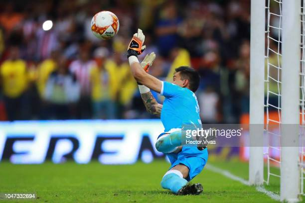 Raul Gudiño of Chivas stops a penalty kick during the 11th round match between America and Chivas as part of the Torneo Apertura 2018 Liga MX at...