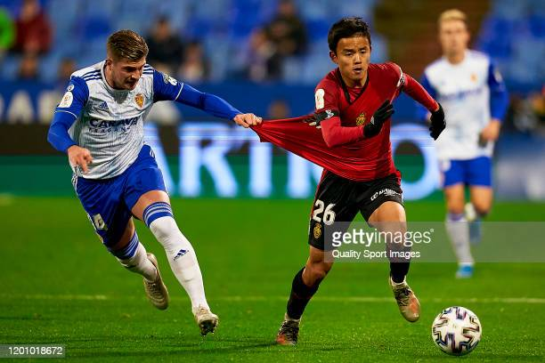 Raul Gutierrez of Real Zaragoza competes for the ball with Takefusa Kubo of RCD Mallorca during the Copa del Rey round of 32 match between Real...