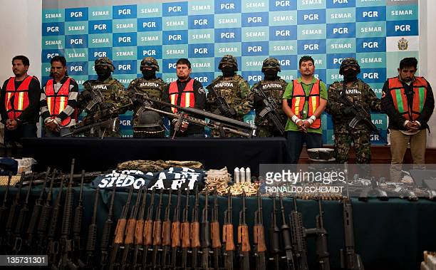 "Raul Hernandez Lechuga aka ""EL Lucky"", is presented to the press along with other alleged member of drugs cartel ""Los Zetas"", in Mexico City, on..."
