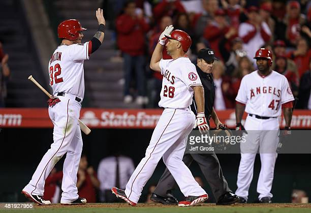 Raul Ibanez of the Los Angeles Angels of Anaheim is congratulated by Josh Hamilton after hitting a tworun home run in the fourth inning against the...