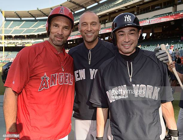 Raul Ibanez of the Los Angeles Angels of Anaheim poses with Derek Jeter and Ichiro Suzuki of the New York Yankees before the game on May 5 2014 at...