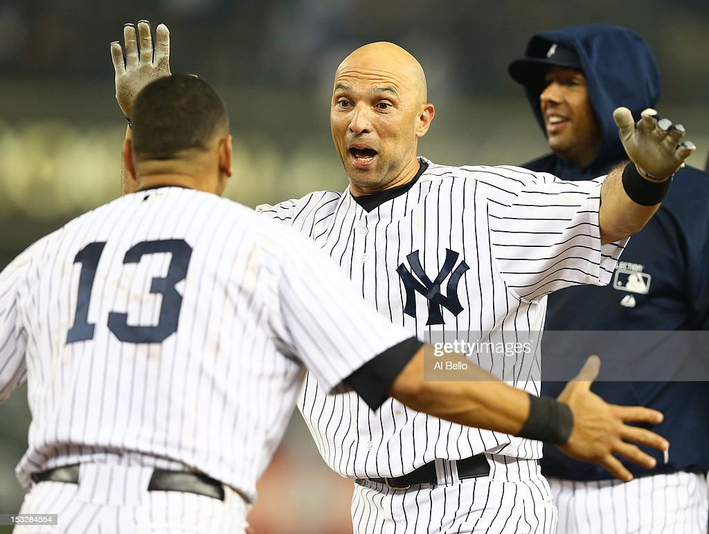 Raul Ibanez #27 of the New York Yankees celebrates with Alex Rodriguez #13 after hitting a walk-off single against the Boston Red Sox in the twelfth inning to win the game 4-3 on October 2, 2012 at Yankee Stadium in the Bronx borough of New York City